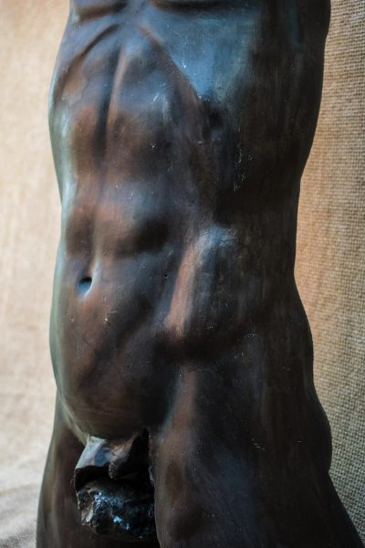 Beech bum. A bronze resin cast sculpture of a male torso in the round.