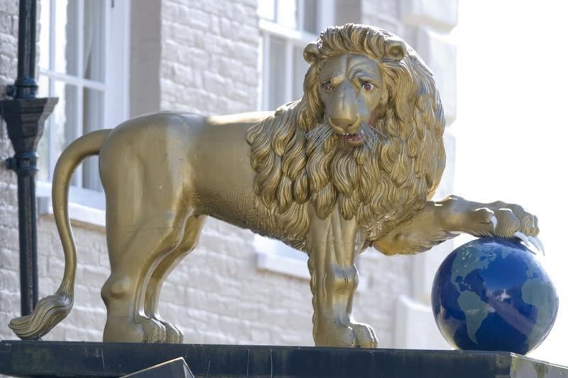 Golden lion statue, Ashburton. The restored statue reinstalled on it's porch roof.