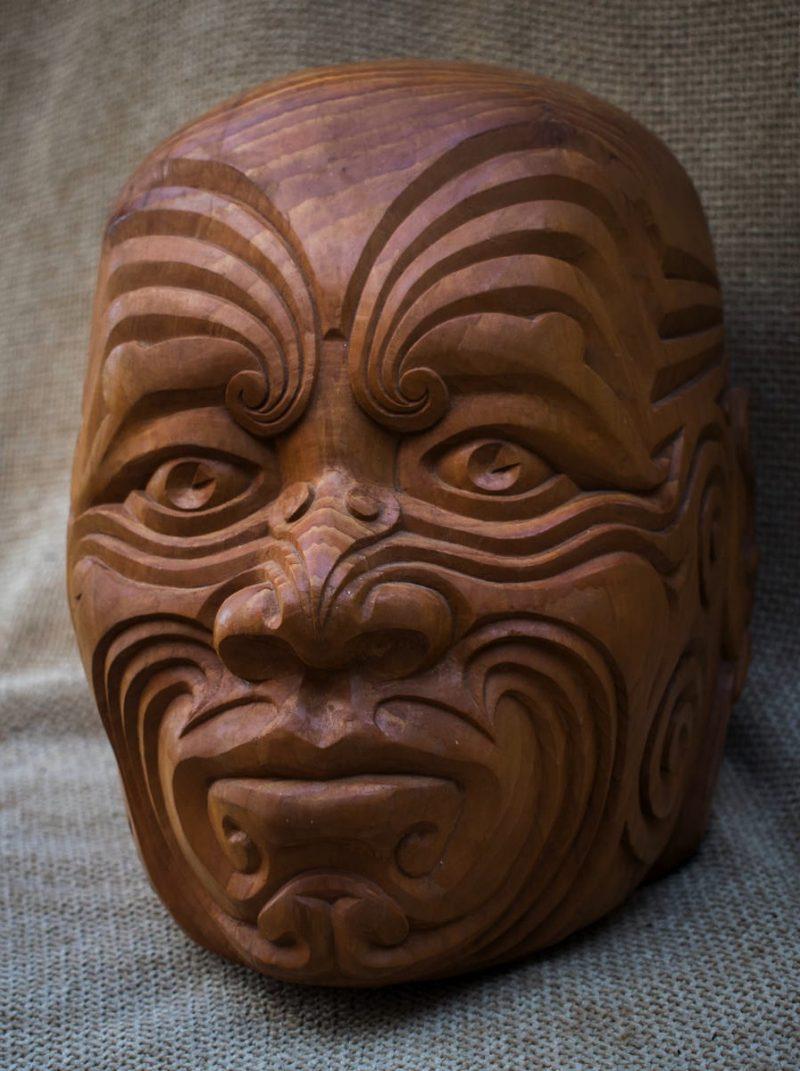 Maori head. A cedar wood carving inspired by Maori face tattooing designs.